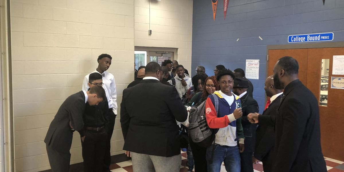 100 Men in Black support students at Tuscaloosa City School