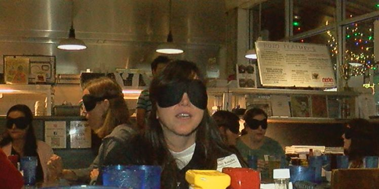 Losing sight to gain insight: diners eat meal blindfolded to understand more about visual impairment