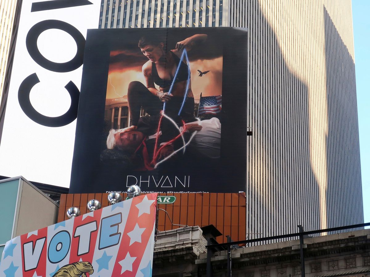 Clothing co. gets attention with Times Square billboard of hog-tied Trump