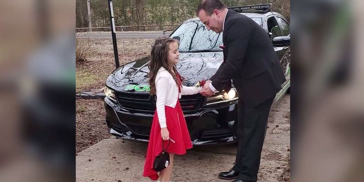 Officer escorts 8-year-old girl to father-daughter dance after her dad's death