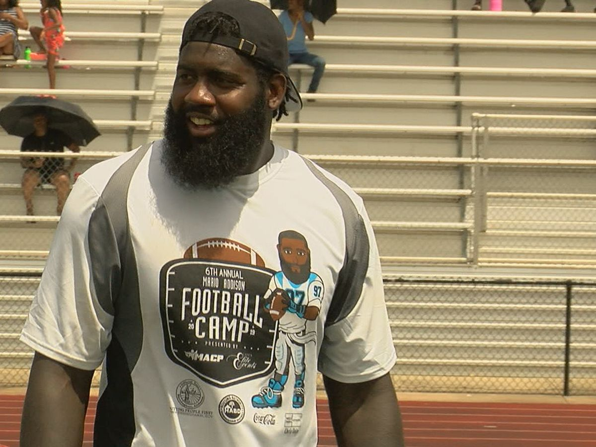Carolina Panthers DE Mario Addison holds youth football camp
