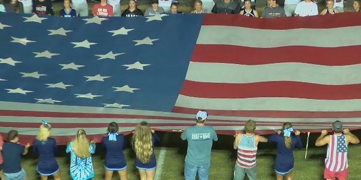 Karle's Korner: Northside and Holy Spirit players carry American flags onto field