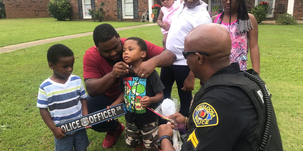 Tuscaloosa boy gets surprise police car parade, sign and toy badge