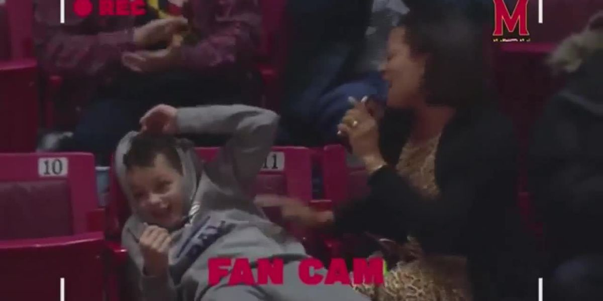 Mom rocks out to Kelly Clarkson on camera at college basketball game