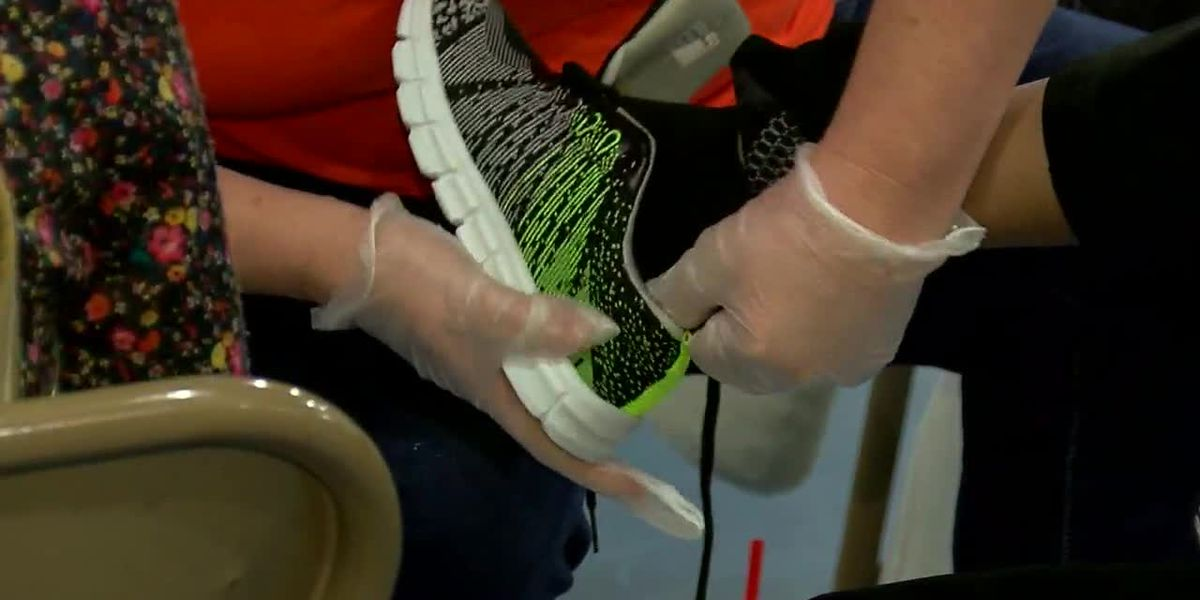 Volunteers wash children's feet and give them new socks and shoes in Fairfield