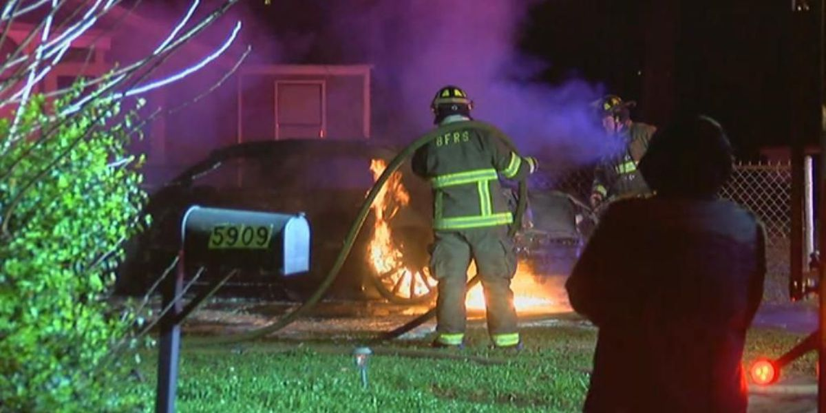 Birmingham firefighters working to put out a double car fire