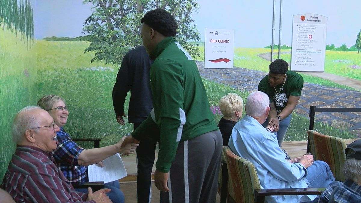 UAB football players visit with veterans at VA Hospital