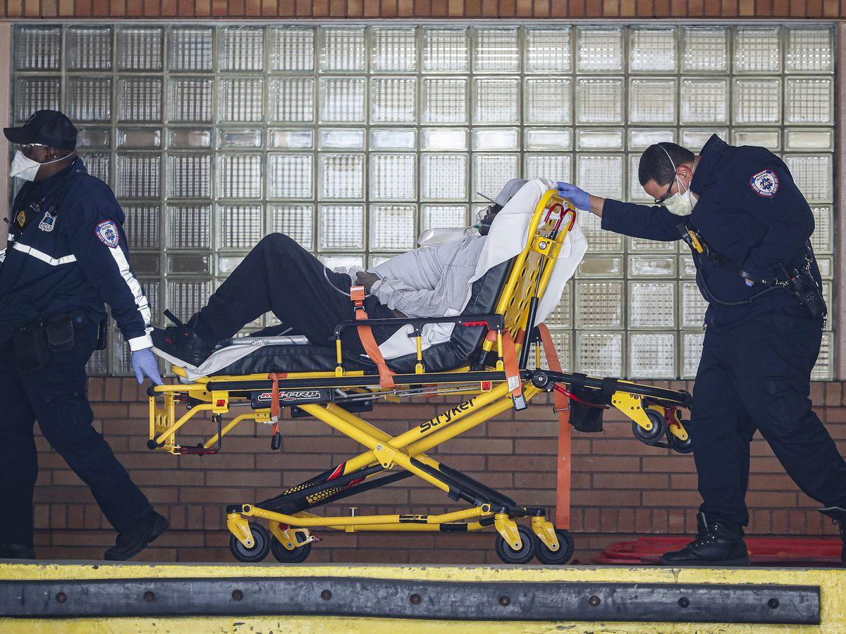 Coronavirus puts UK PM in intensive care; US top doctor hopeful