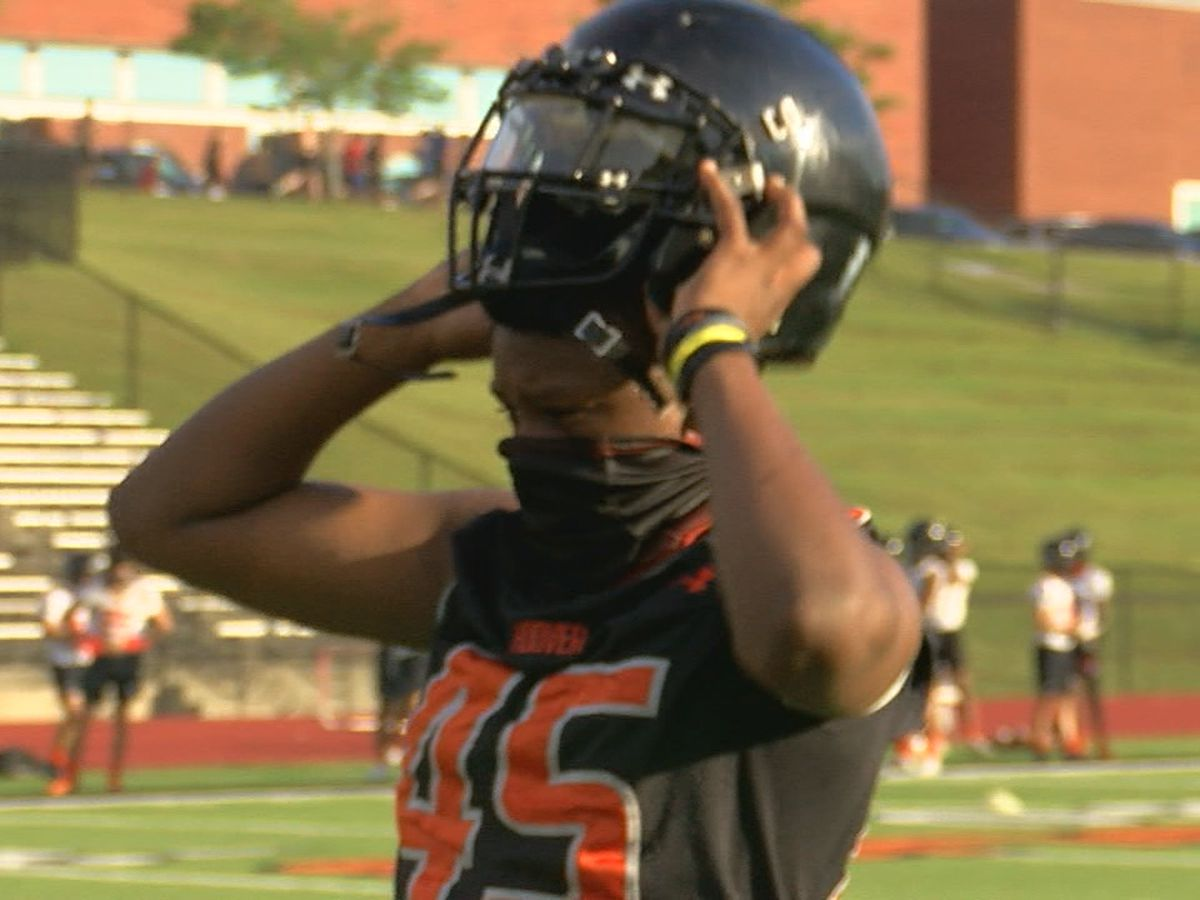 Hoover adjusting to wearing helmets, face masks at practice