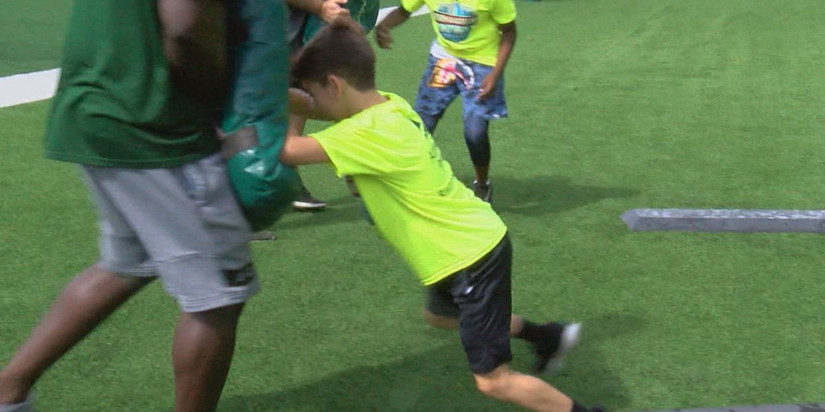 Hundreds of kids learn football skills at Birmingham Bowl Youth Football Clinic