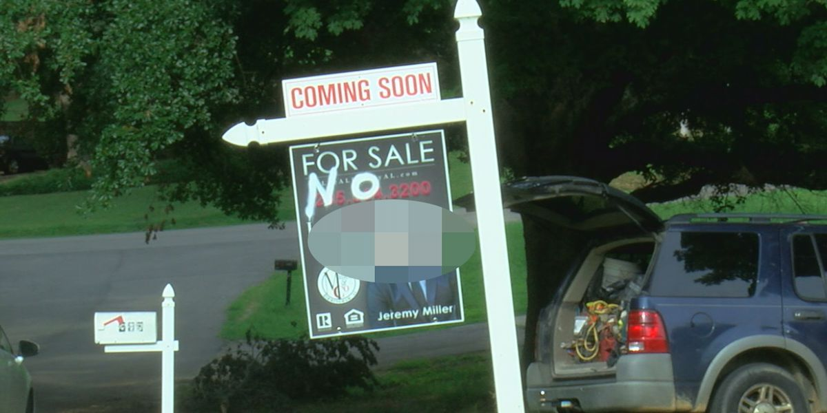 Interracial couple finds racial slur on their real estate sign
