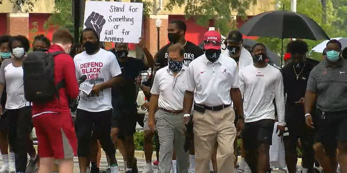 Tide players, students march for social justice