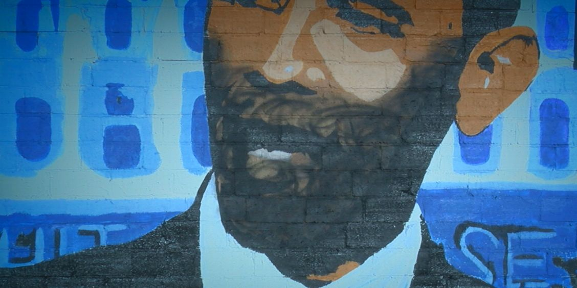 Two artists send message to person who vandalized mural of former president Barack Obama