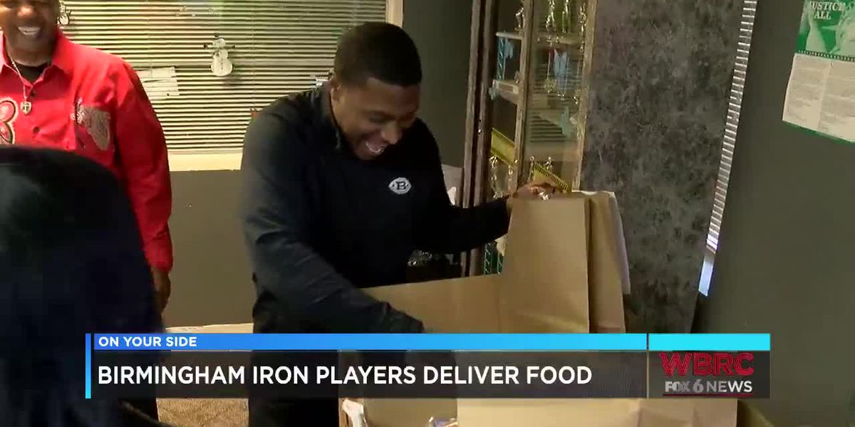 Birmingham Iron players deliver food to needy families