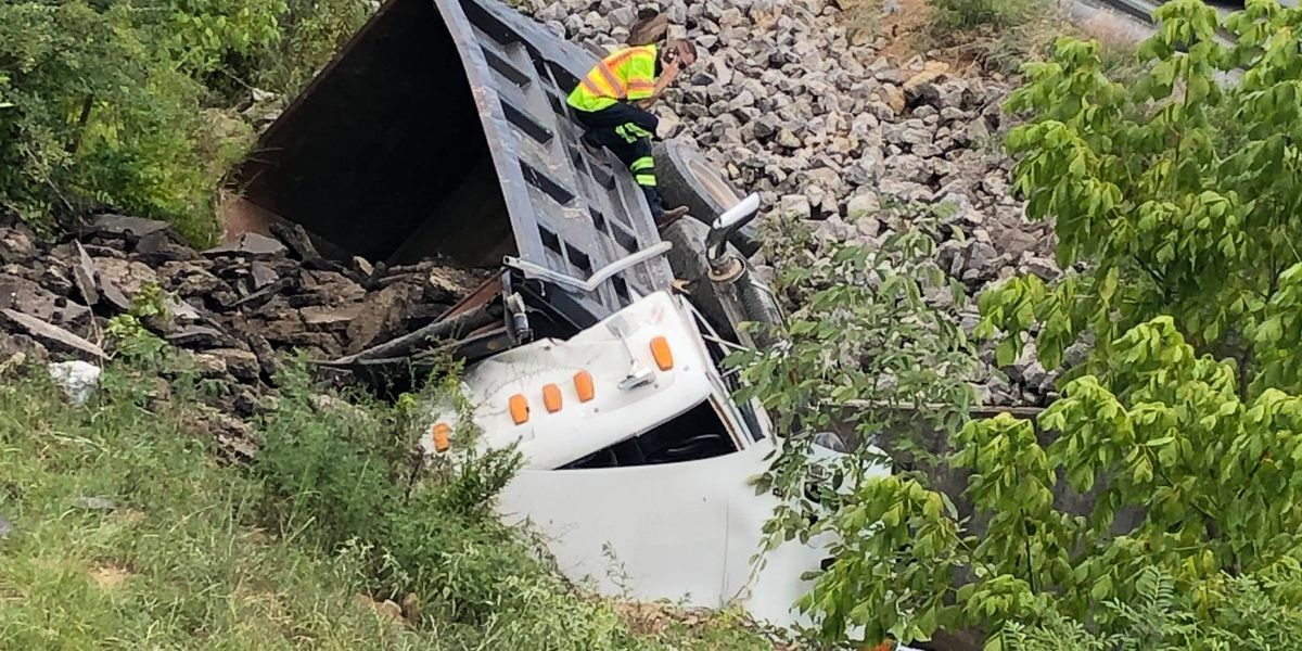 Dump truck runs off road in Hoover, delays traffic