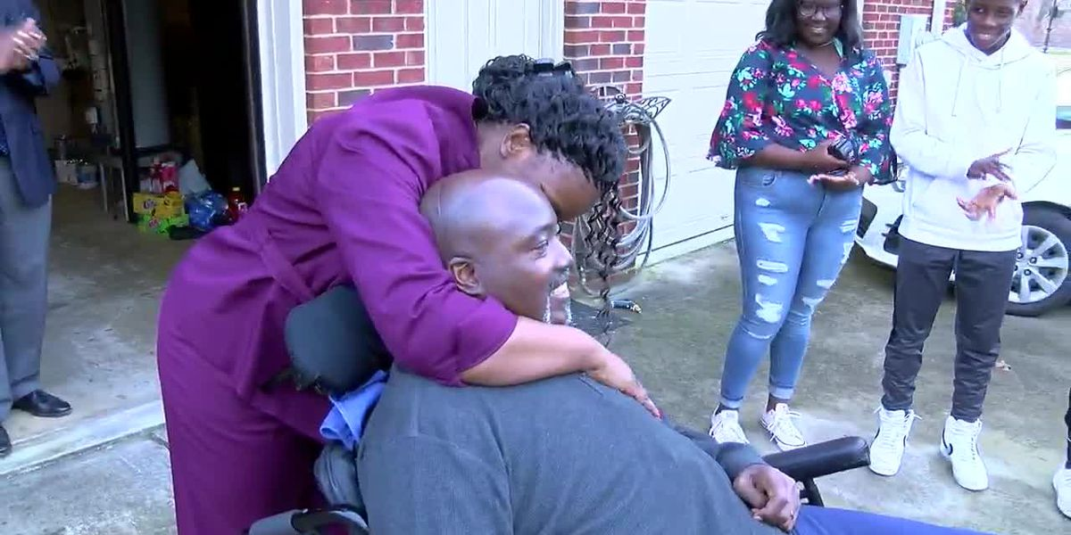 Former Bama football player Willie Wyatt receives a special gift