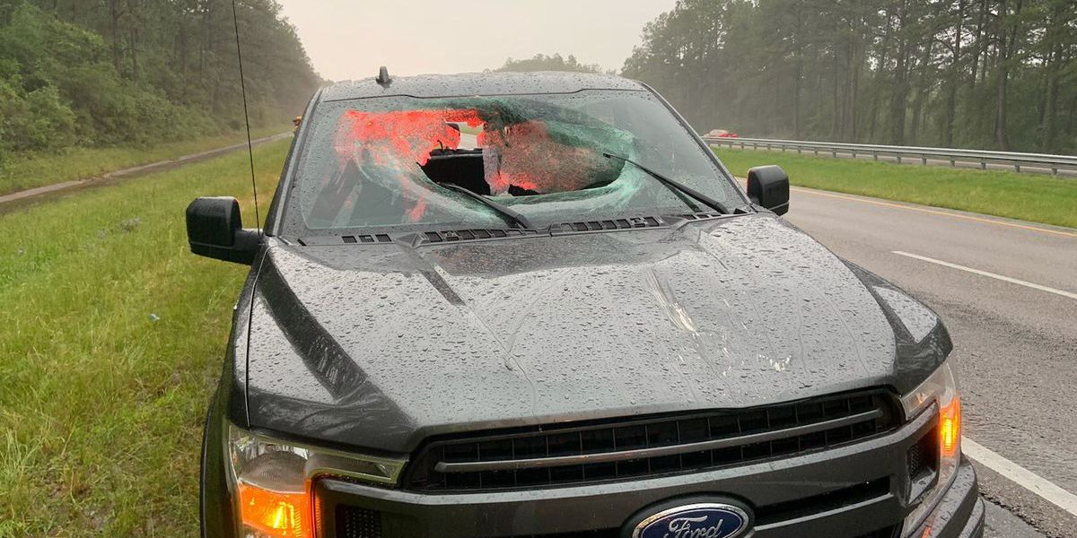 Chunk of road shatters windshield after lightning hits I-10