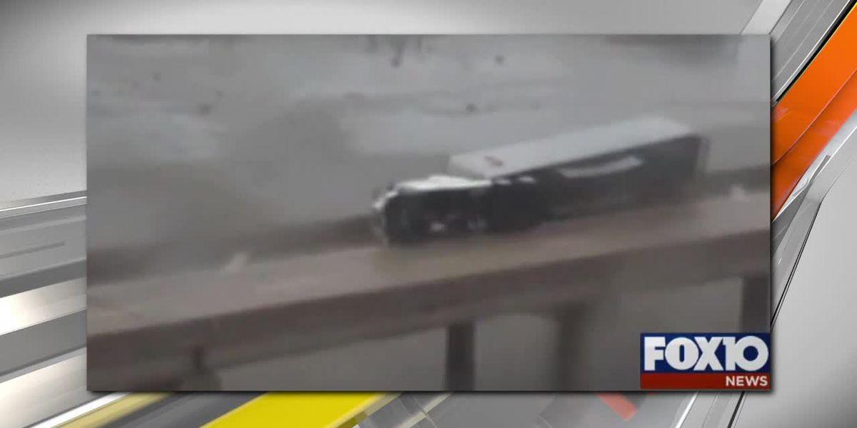 Truck overturns on I-10 in Mobile