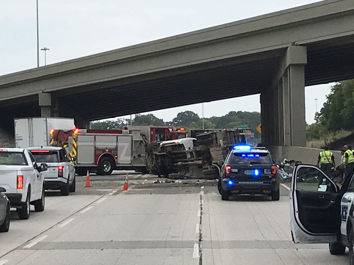 Flipped flatbed truck slowing traffic near I-65 merger with I-59/20