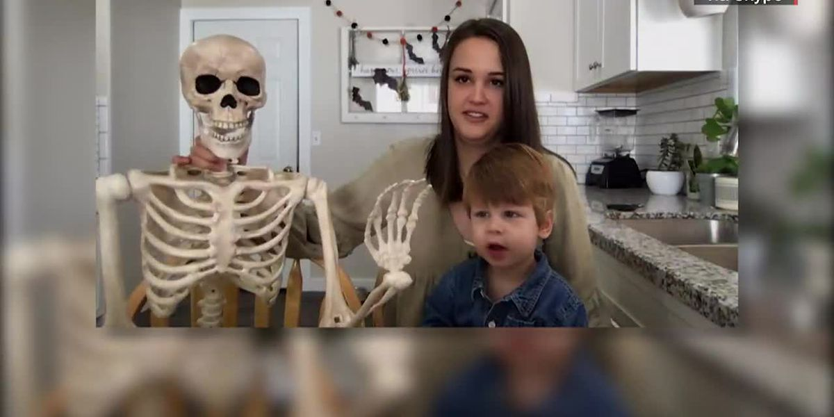 Toddler bonds with Halloween skeleton during COVID-19 pandemic