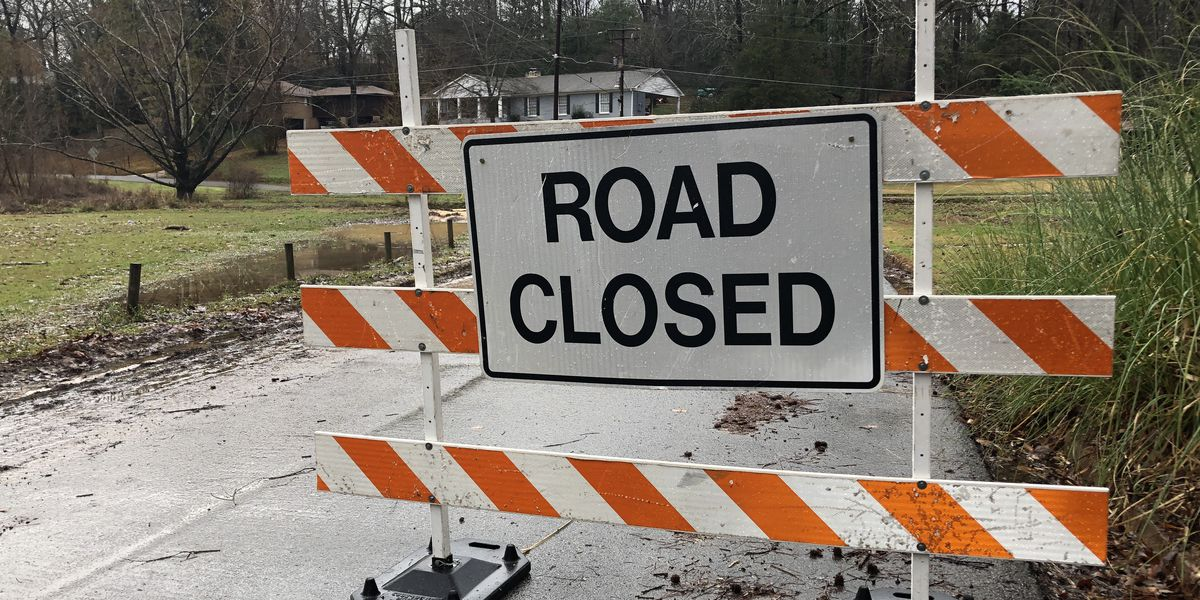 Rain flooded streets and closed roads in Tuscaloosa Thursday