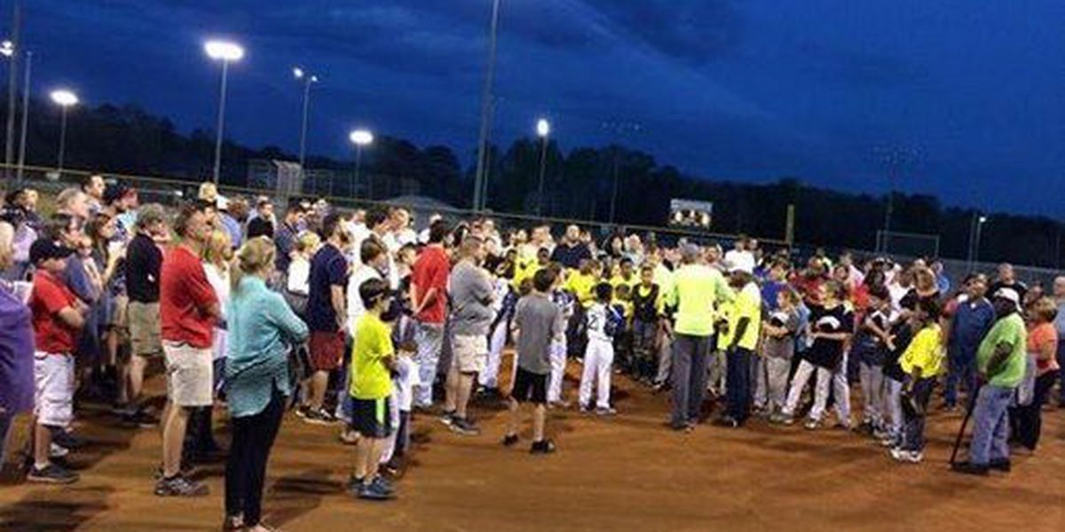 Baseball team prays for 9-year-old recovering from serious dog attack