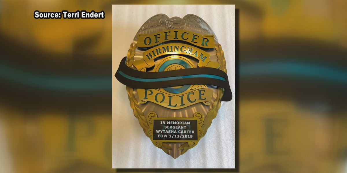 Badge created by wife of police officer to honor Sgt. Wytasha Carter's memory