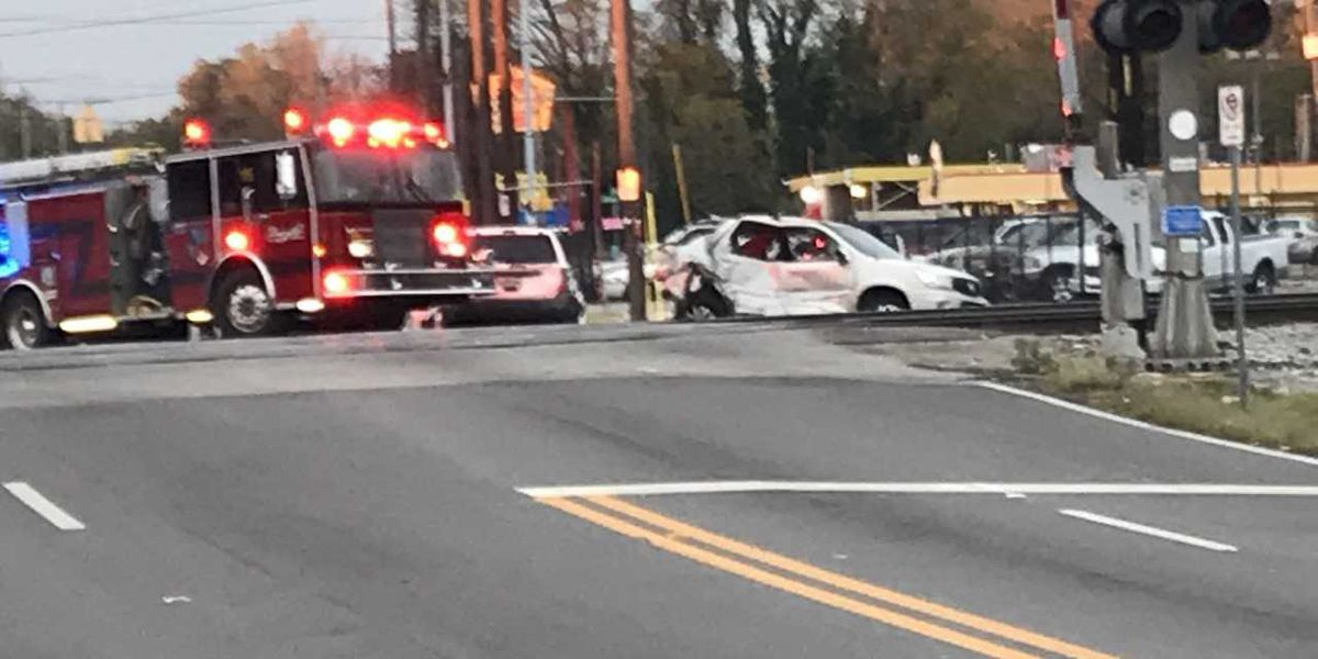 3 sent to hospital after car struck by Amtrak train