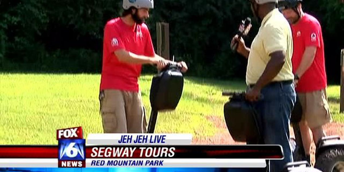 It beats walking! Jeh Jeh tours Red Mountain Park on a Segway