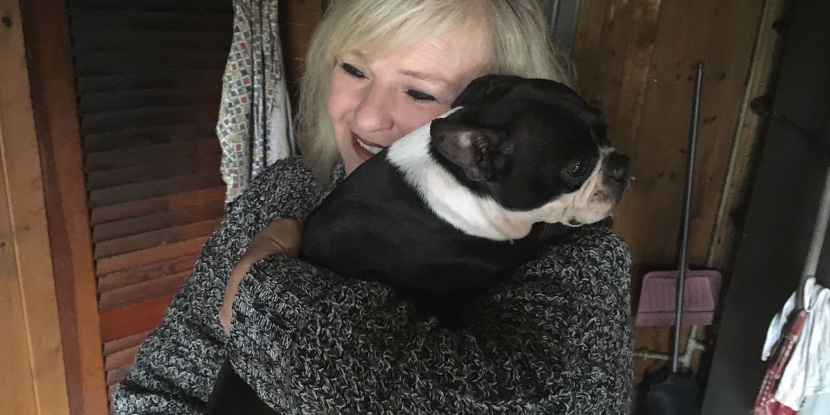 Dog rescues owner from house fire in East AL