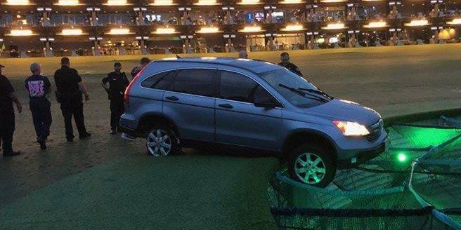 Driver in stolen vehicle rescued after nearly crashing into hole at Topgolf range