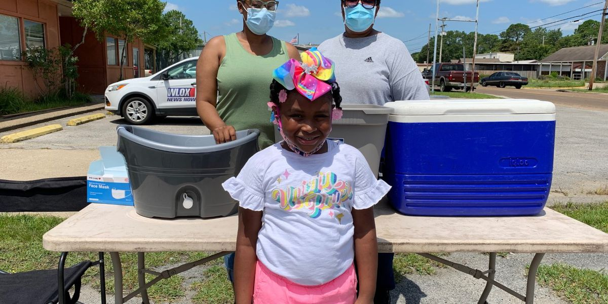 'I just want people to be happy': 6-year-old hands out food, masks to less fortunate