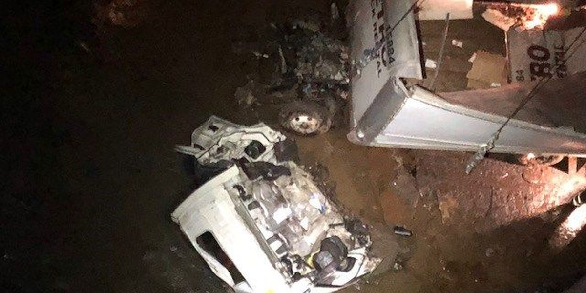 Man pulled from 18-wheeler after it crashes into a creek