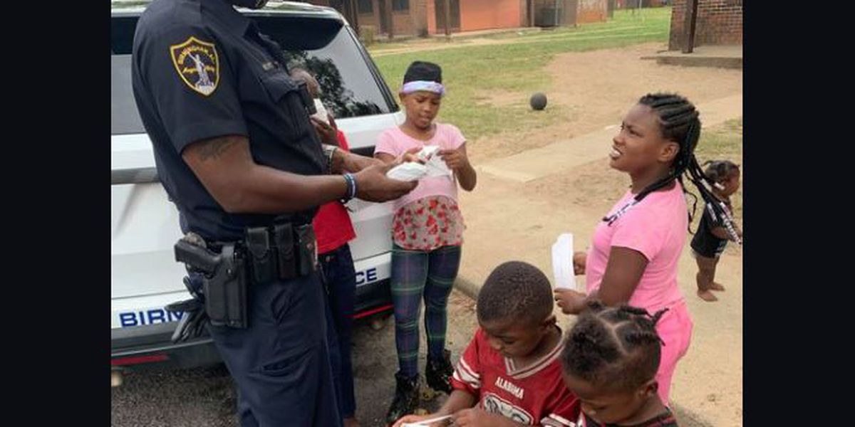 Birmingham police officer hands out free masks and candy