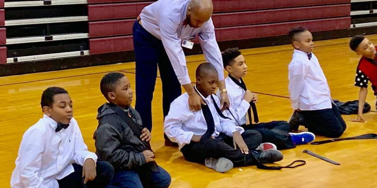 Students growing from Boys II Men one tie at a time