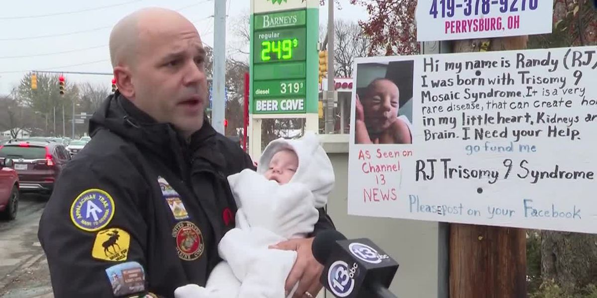 Father throws away cruel signs telling him to let son with rare birth disorders die