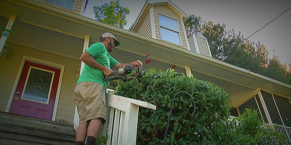 What to do if your neighbor won't cut their grass, stores junk in their yard