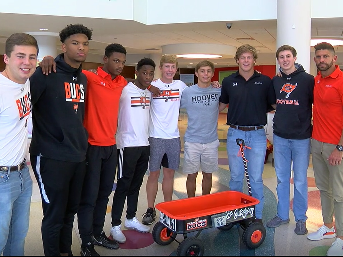 Hoover football players donate wagon to Children's of Alabama