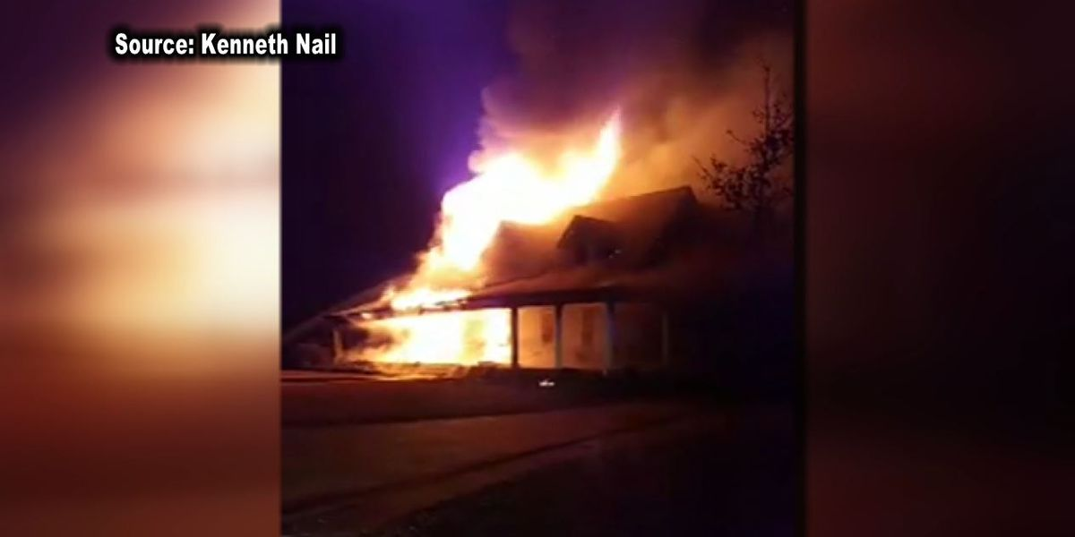 firefighters help colleague after house destroyed by fire