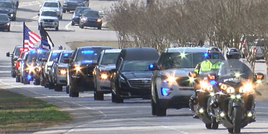Procession moves fallen Officer Nick O'Rear ahead of Monday's funeral