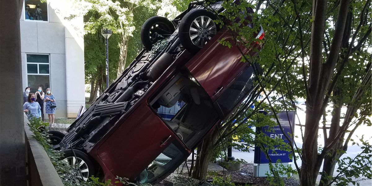Car plunges off third floor of a Huntsville parking deck