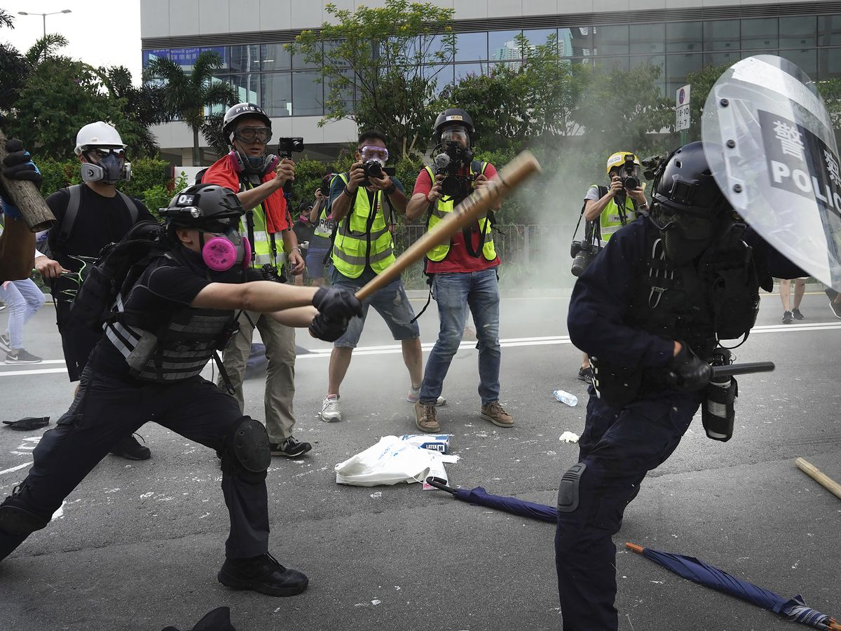 HK police fire tear gas as protests take violent turn again