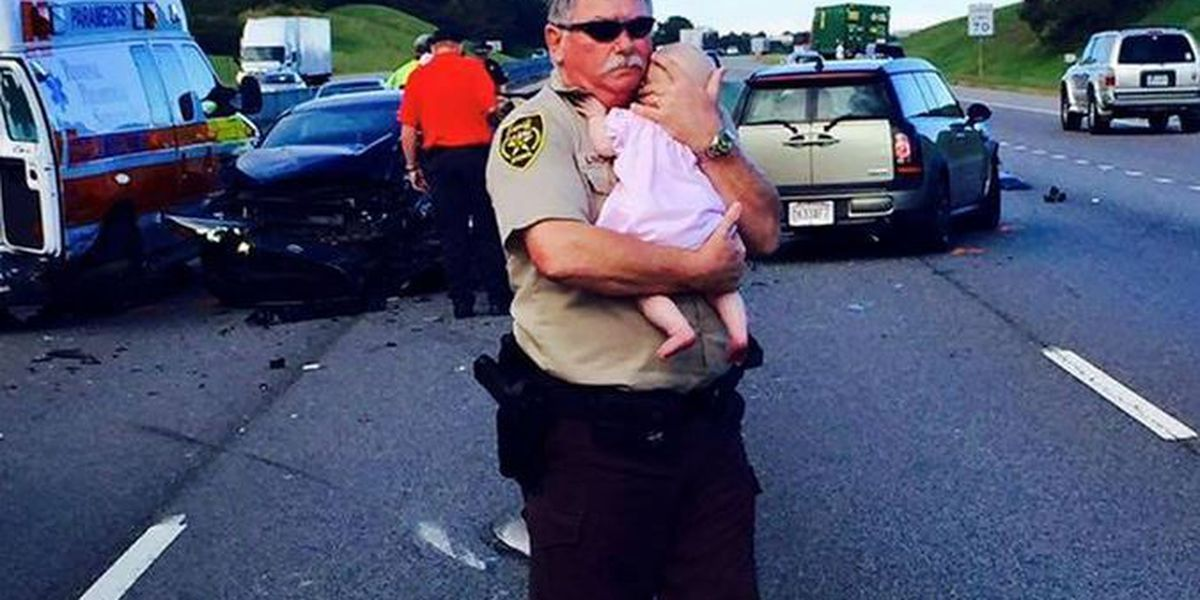 Learn the story behind the photo of a deputy holding a baby after a wreck