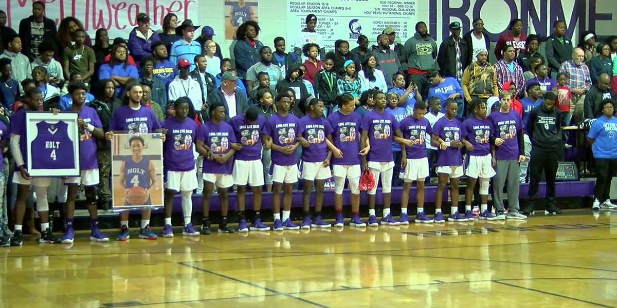 Holt High remembers basketball player killed protecting his sister