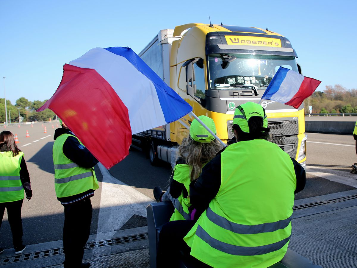 French drivers block oil depots to protest fuel price hikes
