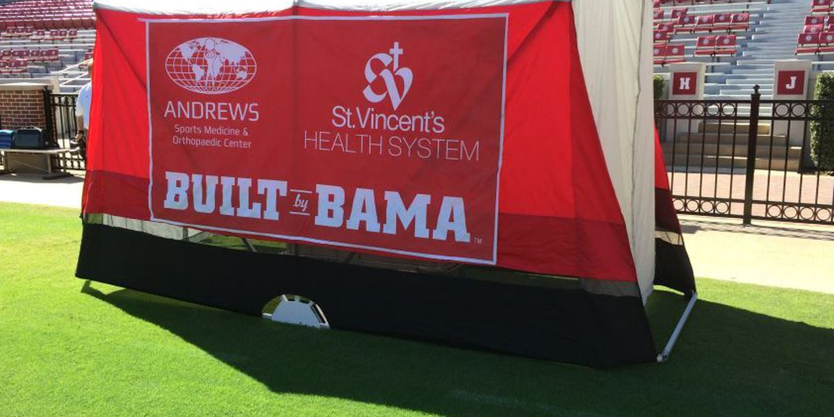 Portable medical tent gives injured Bama players privacy during treatment