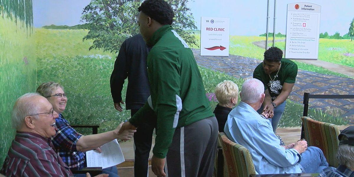 UAB football players visit with veterans at VA Hospital
