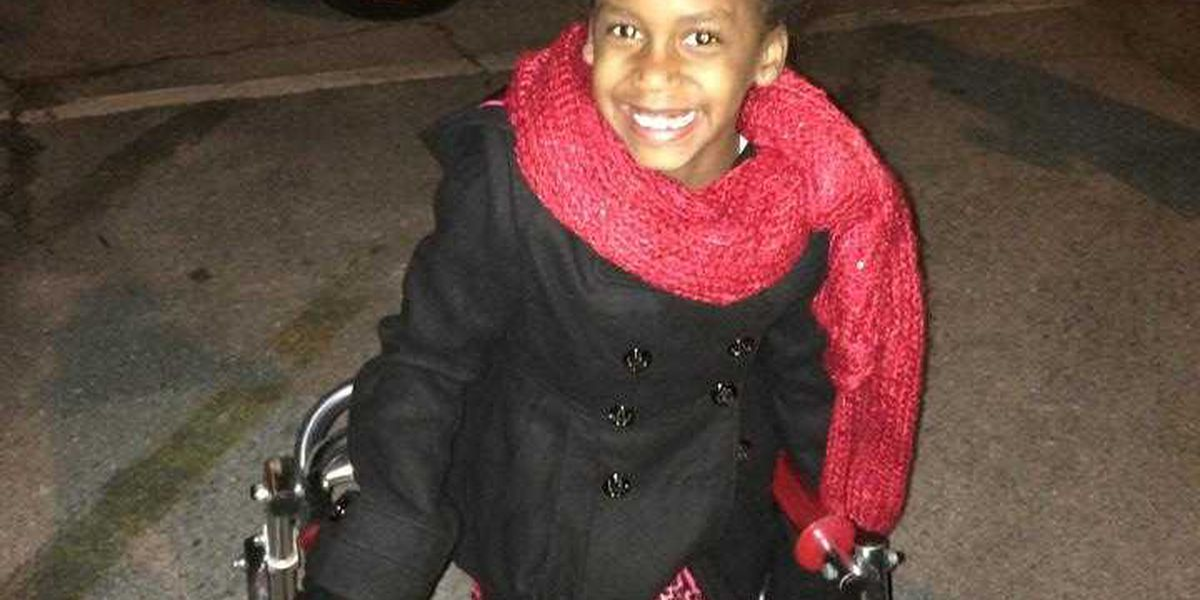 5th grader with cerebral palsy lights Hoover's Christmas tree