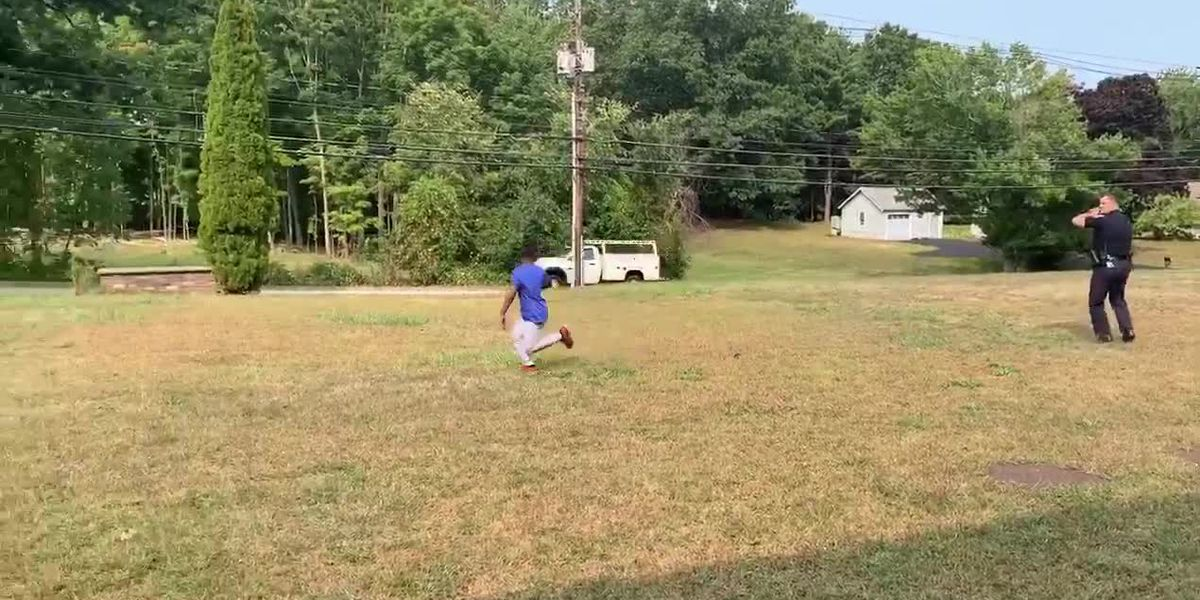 Officer stops to play football with boy who was playing by himself