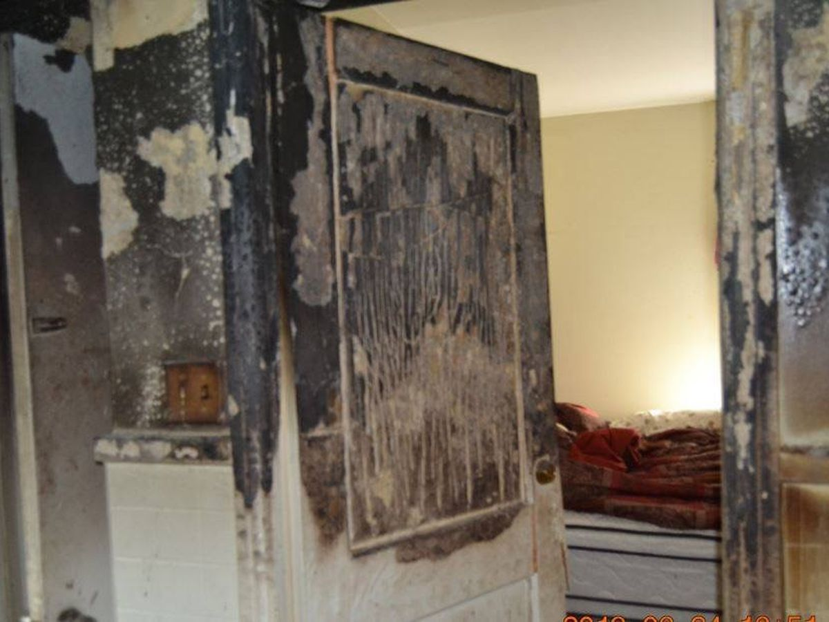 What's the difference between an opened and closed door during a fire?